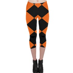 Harlequin Diamond Orange Black Capri Leggings  by CrypticFragmentsColors