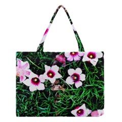 Pink Flowers Over A Green Grass Medium Tote Bag by DanaeStudio