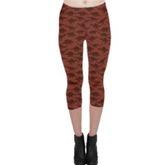 Dark A Pattern With Dinosaur Silhouettes Capri Leggings by CoolDesigns