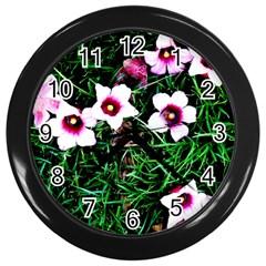 Pink Flowers Over A Green Grass Wall Clocks (black) by DanaeStudio