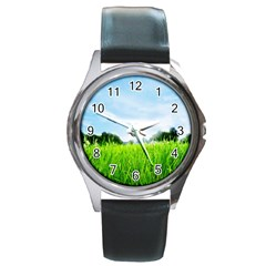 Green Landscape Green Grass Close Up Blue Sky And White Clouds Round Metal Watch by Onesevenart
