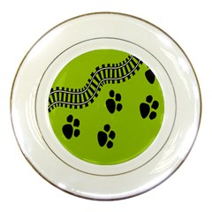 Green Prints Next To Track Porcelain Plates