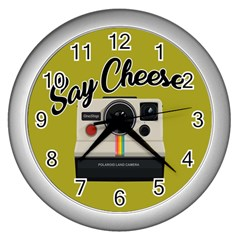 Say Cheese Wall Clocks (silver)  by Valentinaart