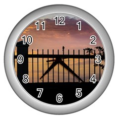Small Bird Over Fence Backlight Sunset Scene Wall Clocks (silver)  by dflcprints